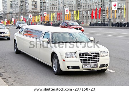 MOSCOW, RUSSIA - MAY 5, 2012: White limousine Chrysler 300C at the city street. - stock photo