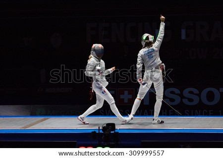 MOSCOW, RUSSIA - MAY 31 2015: Yana Egorian (R) rejoice on final during the World  fencing Grand Prix Moscow Saber in Luzhniki sport palace - stock photo