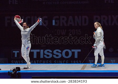 MOSCOW, RUSSIA - MAY 31 2015: Yana Egorian win a fight with Mariel Zagunis on the World fencing Moscow Sabre Grand Prix in Luzhniki sport palace - stock photo