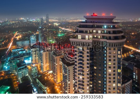 MOSCOW, RUSSIA - NOV 10, 2014: High-rise apartment complex Sparrow Hills and panorama of city. Sparrow Hills complex consists of seven buildings with a total area of 315 sq. meters - stock photo