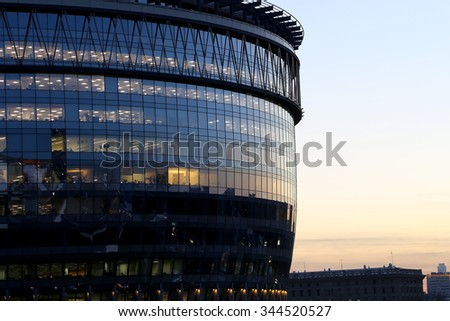 MOSCOW, RUSSIA - NOVEMBER, 06 2015: modern office building with big windows at night, in windows light shines. Moscow, Russia     - stock photo