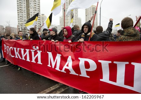 """MOSCOW, RUSSIA - NOVEMBER 4: Russian nationalists  hold anti-immigrant march on Unity Day called """"Russian March"""" in Moscow, Russia on November 4, 2013  - stock photo"""