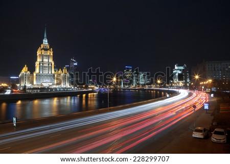 "MOSCOW, RUSSIA - OCTOBER 27, 2014: Night views of Moscow, hotel ""Ukraine"" and Krasnopresnenskaya embankment - stock photo"