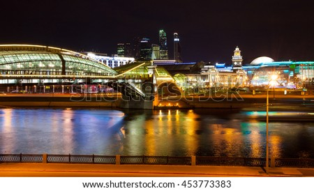 Moscow, Russia. panorama of the city. Night cityscape with Bogdan Khmelnitsky bridge and Kievsky railway station. The movement of vehicles and ship. Color bars on the headlights. Long-term exposure - stock photo