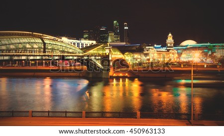 Moscow, Russia. panorama of the city. Night cityscape with Bogdan Khmelnitsky bridge and Moscow river. Kievsky railway station. The movement of vehicles and ship. instagram image filter retro style - stock photo