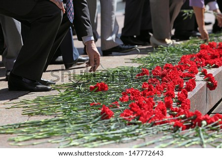 Moscow, Russia. People put flowers to the memorial Tomb of the Unknown Soldier. Events dedicated to the celebration of Victory Day (WWII) - stock photo