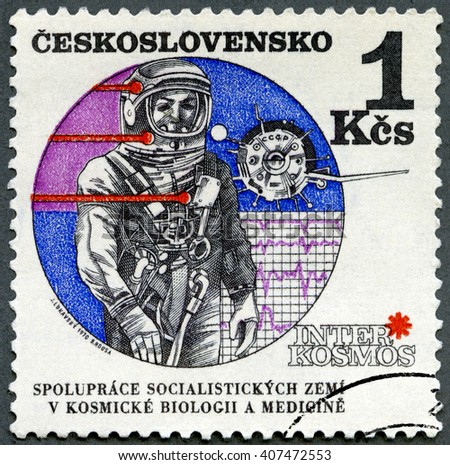 MOSCOW, RUSSIA - SEPTEMBER 21, 2014: A stamp printed in Czechoslovakia shows Astronaut and Vostok satellite. Interkosmos, solar research satellite, 1970 - stock photo
