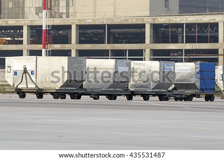 MOSCOW, RUSSIA - SEPTEMBER 26, 2014: Air luggage containers on the platform of the international airport Domodedovo. - stock photo