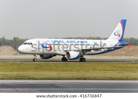 MOSCOW, RUSSIA - SEPTEMBER 26, 2014: Airbus A320 Ural Airlines taxiing. Plane makes taxiing on taxiway Domodedovo International Airport. - stock photo