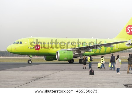 MOSCOW, RUSSIA - SEPTEMBER 26, 2014: Spotter plane photographed S7 Airlines during taxiing. Moscow Domodedovo Airport organizes regular spotting on its territory. - stock photo