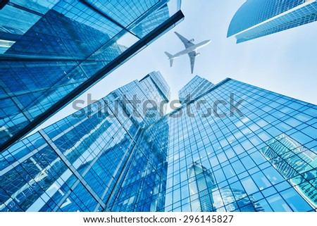 Moscow's skyscrapers and airplanes on sky - stock photo