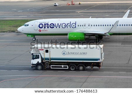 MOSCOW - SEPTEMBER 05: special car for food delivery to the aircraft at the airport Domodedovo in September 05, 2012 in Moscow. Airplane Airbus A321-231 of airline S7 - Siberia Airlines Reg VQ-BKW  - stock photo