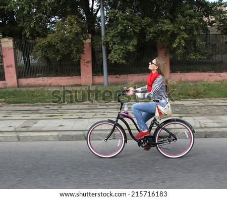 "MOSCOW - SEPTEMBER 07: Unidentified woman ride bicycles at the ""WOW MOSCOW!"" bicycle parade . The event is dedicated to the Day of the city. Taken on September 07, 2014 in Moscow.  - stock photo"