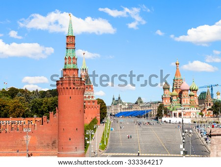 Moscow skyline - Vasilevsky Descent, Walls and Towers of Moscow Kremlin, Saint Basil Cathedral on Red Square of Moscow Kremlin in sunny summer day - stock photo
