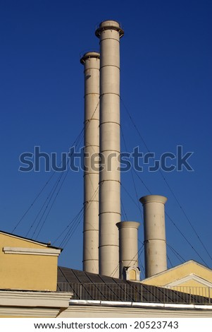 Moscow yellow factory with pipe, Russia - stock photo