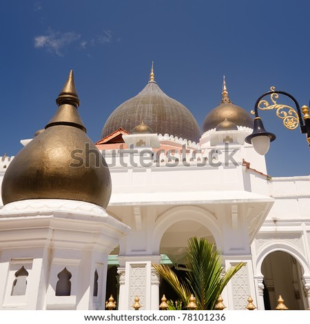 Mosque against blue sky with golden doom in daytime. - stock photo