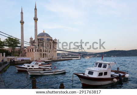 Mosque of Ortakoy and Bosphor bridge connecting Europe and Asia - stock photo
