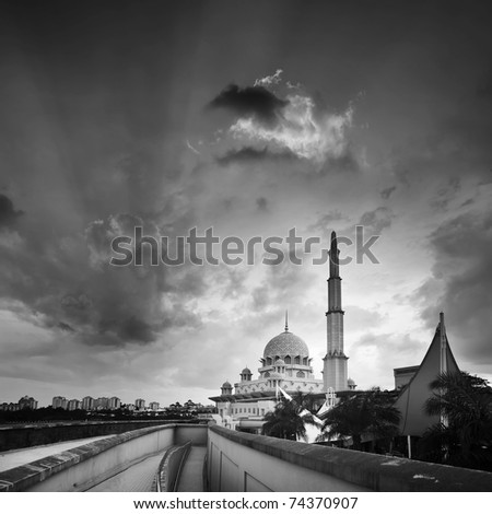 Mosque under dramatic sky in sunset in black and white. - stock photo