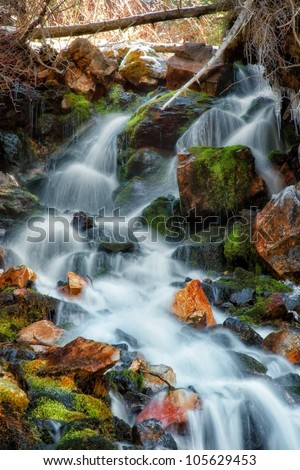 moss cover rocks in waterfall/ The Spring Time Waterfall/ moss waterfall - stock photo
