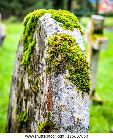Moss covered grave stone - stock photo