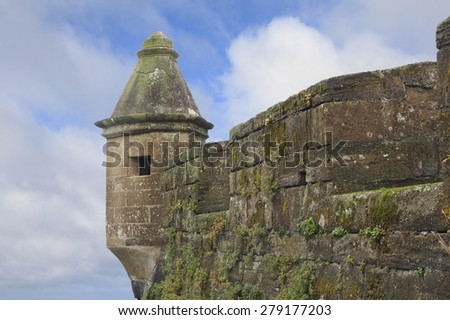 Moss Covered Walls and Tower of the Medieval Fort in Horta, Portugal, Azores - stock photo