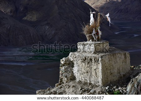 Most Tibetan Buddhist stupa ancient close-up, stand in the holy place, on a dark background mountains, Zanskar, Himalayas, Northern India. - stock photo