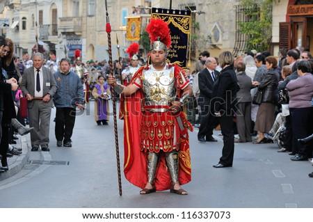 MOSTA, MALTA - APR 22 - Roman centurion during in the Good Friday procession in the village of Mosta in Malta April 22, 2011 - stock photo