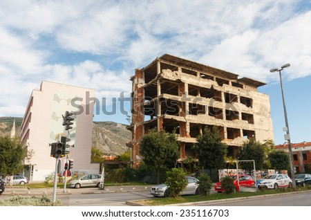 MOSTAR, BOSNIA-HERZEGOVINA - OCTOBER 24, 2014: destroyed building at the former front line of the war on Mostar. The signs of the Yugoslavian wars are still visible on many buildings in Mostar. - stock photo