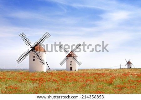MOTA DEL CUERVO, SPAIN - JUNE 10, 2014: Windmills. Touristic Don Quixote route that goes through 148 towns and was distinguished in 2007 as a European Cultural Route.                         - stock photo