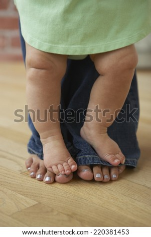 Mother ad baby's feet - stock photo