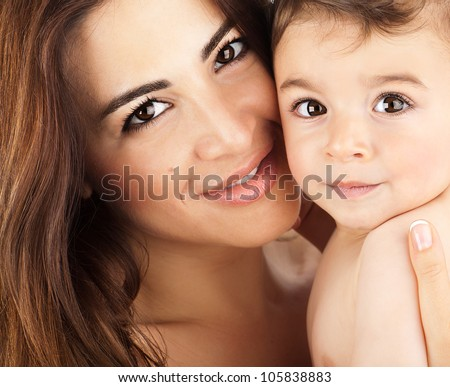 Mother and baby closeup portrait, happy faces, Arabic family picture, adorable small boy, mom and kid having fun indoor, parents joy, holding little child, healthy toddler and mommy, happiness concept - stock photo