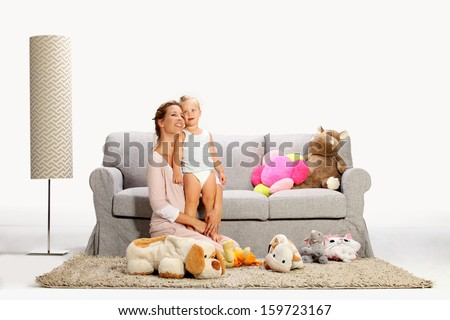 Mother and baby daughter playing 8 - stock photo