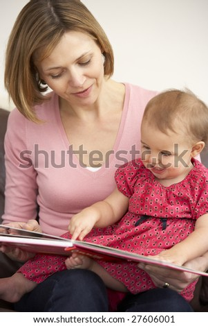 Mother And Baby Daughter Reading Book - stock photo