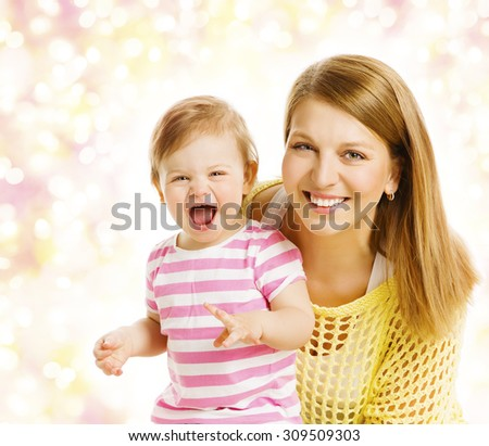 Mother and Baby Girl Family Portrait, Smiling Woman with Happy Laughing Kid, Daughter one year old - stock photo