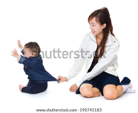 Mother and baby having fun - stock photo