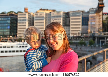 mother and baby in the port - stock photo