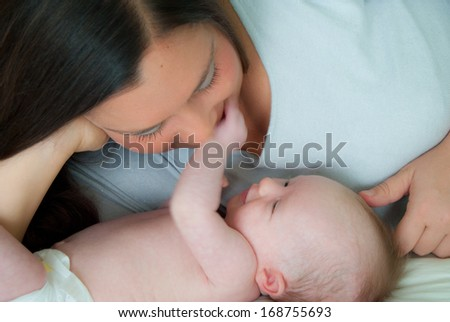 Mother and Baby Looking at Each Other - stock photo