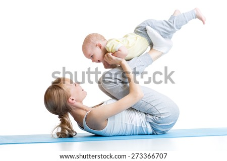 mother and baby make gymnastics, yoga exercises isolated on white  - stock photo