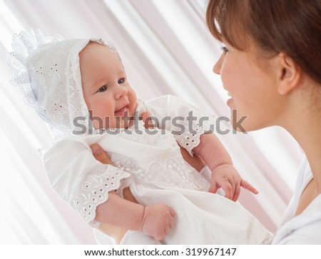 Mother and baby playing and smiling. Happy family.Home interior. - stock photo