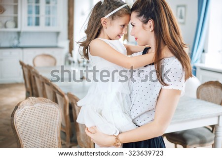 Mother and baby relaxing in a stylish interior - stock photo