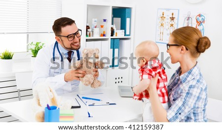mother and baby toddler on reception at the child pediatrician - stock photo