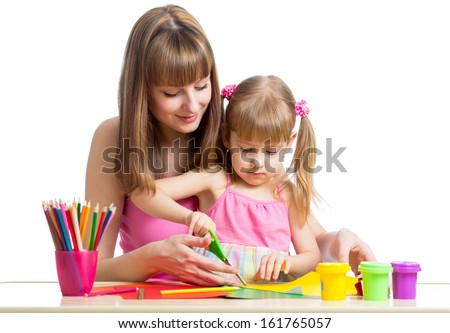 Mother and child draw and cut together - stock photo