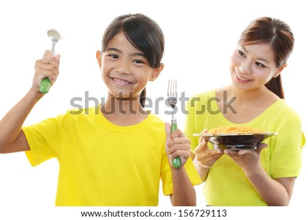 Mother and child eating food - stock photo