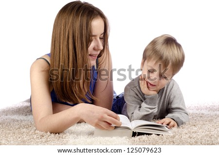 Mother and child having fun while teaching and playing together. - stock photo