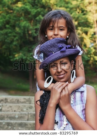 Mother and child in a summer day - stock photo