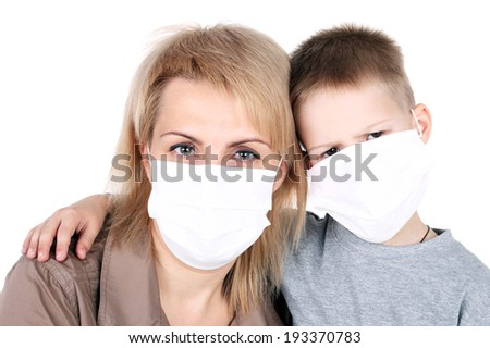 mother and child in the protective masks - stock photo