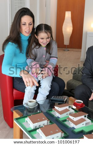 Mother and child looking at a building model - stock photo