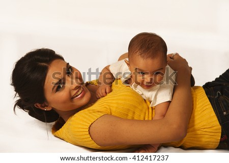 Mother and child lying - stock photo