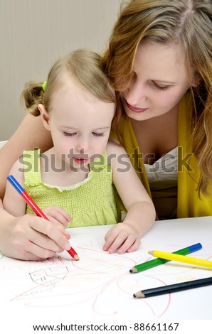 Mother and child painting - stock photo