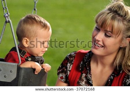 Mother and child playing outdoor - stock photo